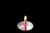 Time lapse. Red cake candle burning