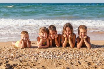 Five kids on the beach
