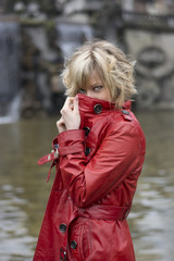 Attractive young woman with red leather jacket