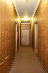 Long vintage hotel corridor