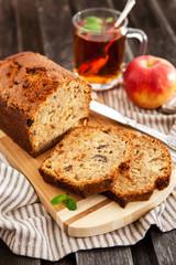 Apple nut cake on wooden board