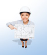 businesswoman in helmet showing with blueprint