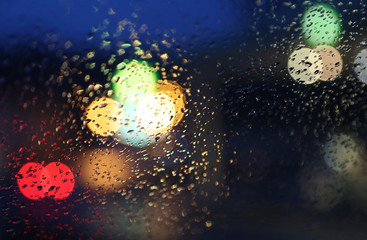 Night rainy car window