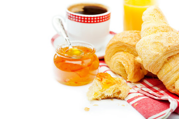 Continental breakfast with croissants, marmalade and coffee