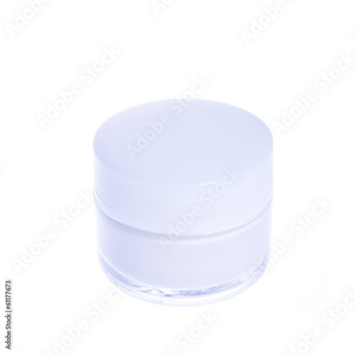 cosmetic cream in a glass jar with white cover