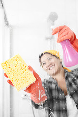 cleaning it with yellow sponge