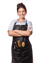 Professional hairdresser woman.In professional outfit with tools