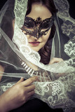 Vestal.Veiled virgin, spirituality concept. woman with mask posi