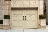 Closed Ornate Swinging Beige Garage Doors of an Upscale Home