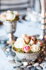 Bouquet of roses on table at wedding reception