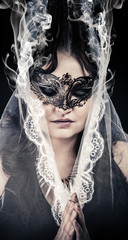 Fantasy.Veiled virgin, spirituality concept. woman with mask pos