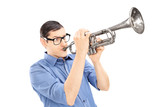 Young male trumpeter playing the trumpet