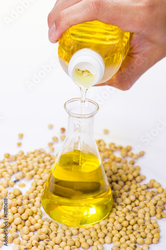 pouring yellow soya bean oil