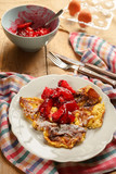 Sweet omelette with caramelized red plums