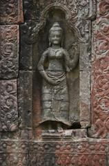 Apsara carved on the stone columns of Angkor Wat