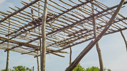Framework for a wooden house on piles. Cambodian village