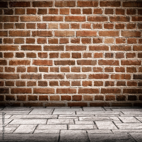 Red brick wall and brick floor interior