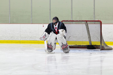 Goalie gets ready for the puck during an ice hockey game