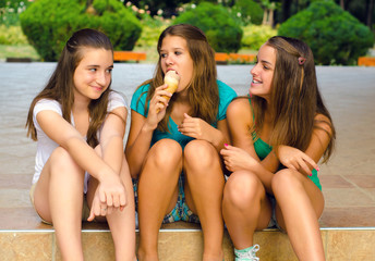 Three teenage girls and one ice cream