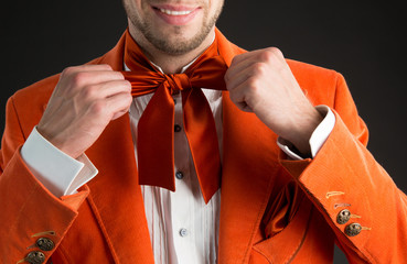 Man wearing orange bow tie