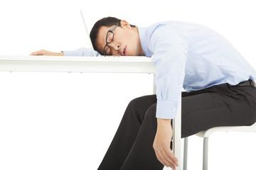 Tired overworked businessman sleeps on desk