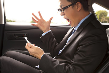 angry businessman shouting on the phone with gesture
