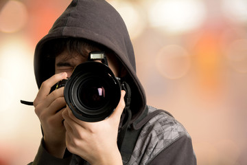 Portrait of young man photographer with camera