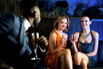 Elegant man looking at hot young girls