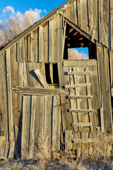 Side of a rustic old weathered barn