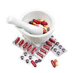 mortar. pestle and pills