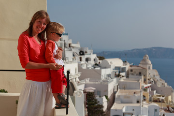 family enjoying view of santorini