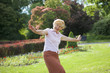 Delighted Playful Mature Woman with Outstretched Arms Laughing