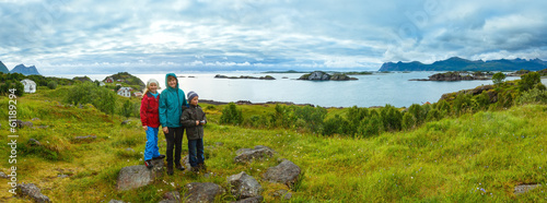 Family near summer Senja coast (Norway, polar night)