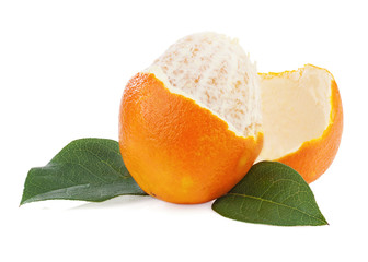 Peeled orange fruit with green leaves isolated on white backgrou