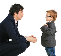 little boy and businessmen communicate, isolation on white