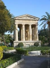 Antic monument in garden, La Valleta, Malta