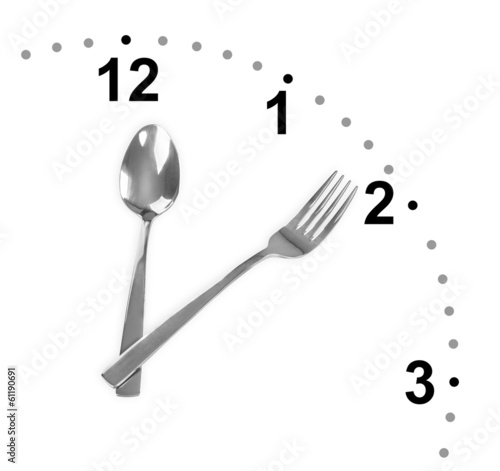 Clock made of fork and spoon isolated