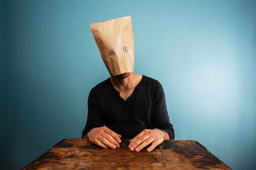 Stupid man with bag over his head