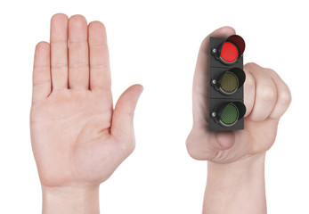 Concept denying access, hand holding traffic light. Isolated