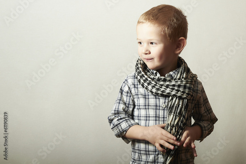 Child. funny little boy in scurf. Fashion Children. 4 years old