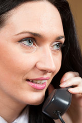 Close-up of office worker talking on landlines phone