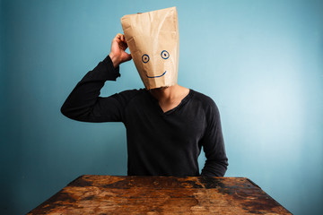 Confused man with bag over his head