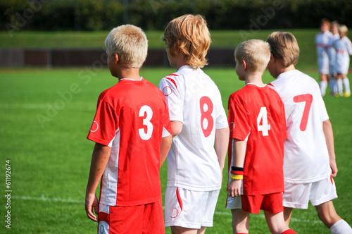 canvas print picture Vier junge Fußballer