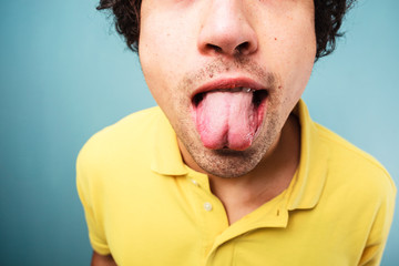 Man sticking his tongue out