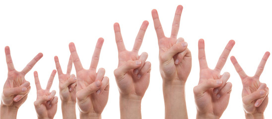 Young people showing the peace sign