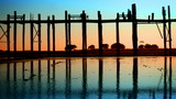 People on the old teak bridge. Burma, Mandalay, sunset