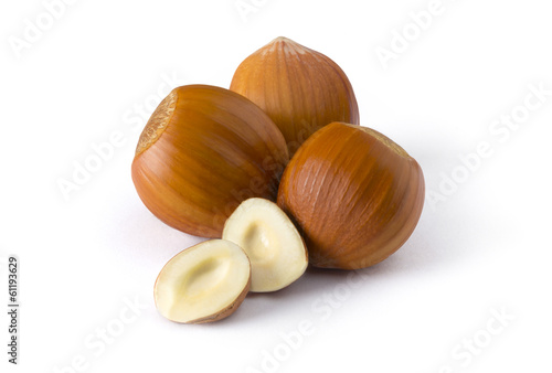 Isolated group of hazelnuts on white background