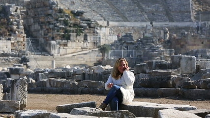 tourist talking phone in ruins ancient Ephesus,steadicam shoot
