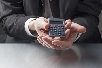 handing a calculator for sales performance