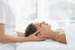 Woman receiving body massage in health spa